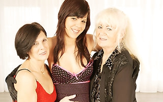 Three naughty old and young lesbians at play