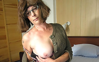 Shaved mature slut playing with a banana