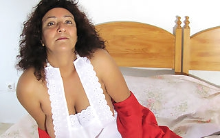 Naughty mature Madhia loves to get wet