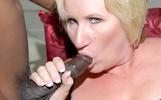 Kinky mama getting two black cocks at once