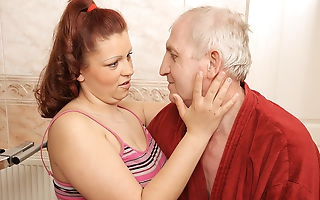 Horny old geezer doing a big titted teen